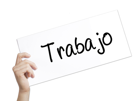 Trabajo  ( work in Spanish) Sign on white paper. Man Hand Holding Paper with text. Isolated on white background.  Business concept. Stock Photo Stock Photo