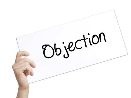 objection: Objection Sign on white paper. Man Hand Holding Paper with text. Isolated on white background.  Business concept. Stock Photo Stock Photo