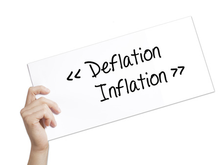 Paper with text Deflation - Inflation . Man Hand Holding Sign on white paper. Isolated on white background.  Business concept. Stock Photo