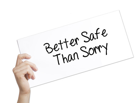 better safe than sorry: Paper with text Better Safe Than Sorry . Man Hand Holding Sign on white paper. Isolated on white background.  Business concept. Stock Photo