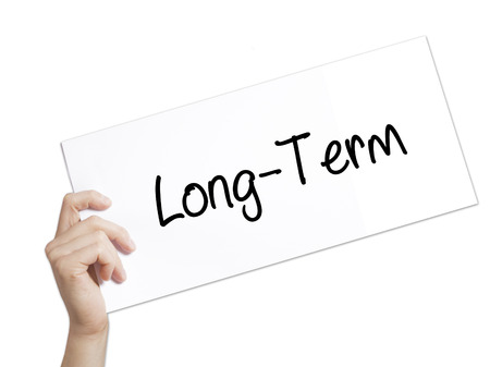 Long-Term Sign on white paper. Man Hand Holding Paper with text. Isolated on white background.   Business concept. Stock Photo Stock Photo