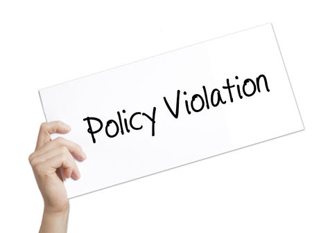 violating: Policy Violation Sign on white paper. Man Hand Holding Paper with text. Isolated on white background.   Business concept. Stock Photo Stock Photo