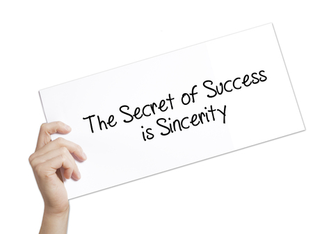 The Secret of Success is Sincerity Sign on white paper. Man Hand Holding Paper with text. Isolated on white background.  Business concept. Stock Photo Stock Photo