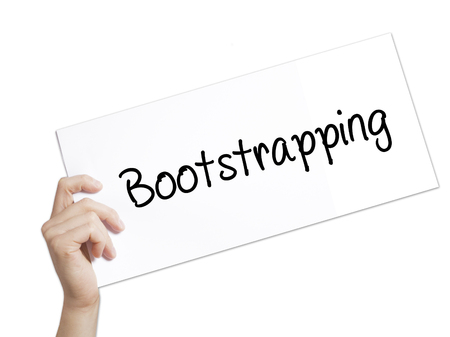 bootstrap: Paper with text Bootstrapping . Man Hand Holding Sign on white paper. Isolated on white background.  Business concept. Stock Photo