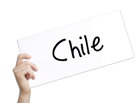 wine road: Paper with text Chile  . Man Hand Holding Sign on white paper. Isolated on white background.   Business concept. Stock Photo Stock Photo