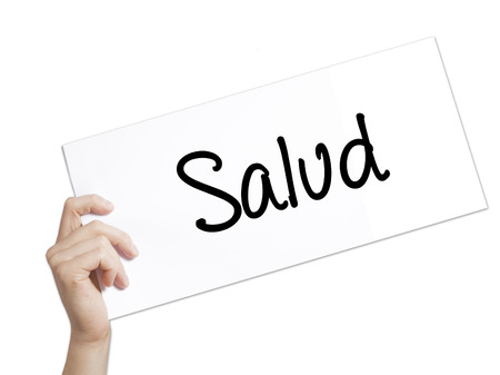 Salud (Health in Spanish) Sign on white paper. Man Hand Holding Paper with text. Isolated on white background.  Business concept. Stock Photo Stock Photo