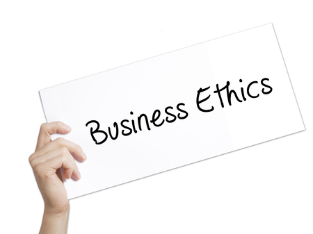 uprightness: Business Ethics Sign on white paper. Man Hand Holding Paper with text. Isolated on white background.  Business concept. Stock Photo Stock Photo