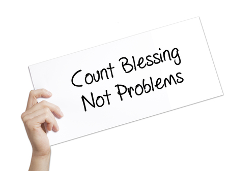 blessings: Paper with text Count Blessing Not Problems . Man Hand Holding Sign on white paper. Isolated on white background.  Business concept. Stock Photo
