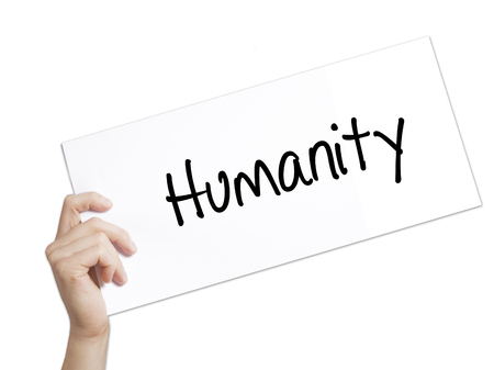 clemency: Humanity  Sign on white paper. Man Hand Holding Paper with text. Isolated on white background.  Business concept. Stock Photo
