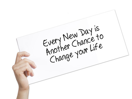 Every New Day is Another Chance to Change your Life Sign on white paper. Man Hand Holding Paper with text. Isolated on white background.   Business concept. Stock Photo