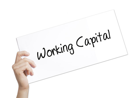 Working Capital Sign on white paper. Man Hand Holding Paper with text. Isolated on white background.   Business concept. Stock Photo