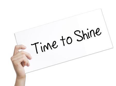 popularity: Time to Shine Sign on white paper. Man Hand Holding Paper with text. Isolated on white background.   Business concept. Stock Photo Stock Photo