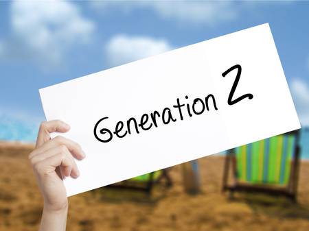 Generation Z Sign on white paper. Man Hand Holding Paper with text. Isolated on holiday background.  Business concept. Stock Photo Stock Photo