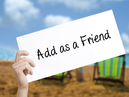 add as friend: Add as a Friend Sign on white paper. Man Hand Holding Paper with text. Isolated on holiday background.  Business concept. Stock Photo