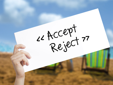 approvement: Accept - Reject  Sign on white paper. Man Hand Holding Paper with text. Isolated on holiday background.  Business concept. Stock Photo