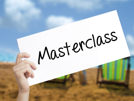 elearn: Masterclass Sign on white paper. Man Hand Holding Paper with text. Isolated on holiday background. Education Business concept. Stock Photo Stock Photo
