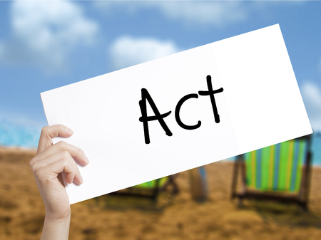 Act  Sign on white paper. Man Hand Holding Paper with text. Isolated on holiday background.  Business concept. Stock Photo Stock Photo