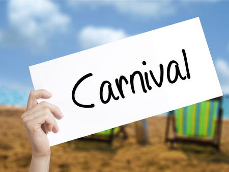 Carnival Sign on white paper. Man Hand Holding Paper with text. Isolated on holiday background.   Business concept. Stock Photo Imagens