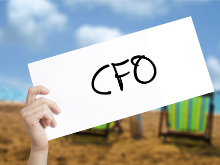 comité d entreprise: CFO (Chief Financial Officer) Sign on white paper. Man Hand Holding Paper with text. Isolated on holiday background.  Business concept. Stock Photo Banque d'images