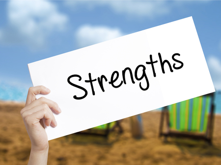 appraise: Strengths Sign on white paper. Man Hand Holding Paper with text. Isolated on holiday background.  Business concept. Stock Photo