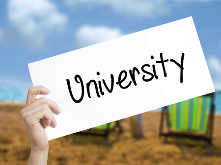 master degree: University Sign on white paper. Man Hand Holding Paper with text. Isolated on holiday background.   Business concept. Stock Photo Stock Photo