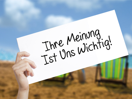 wichtig: Ihre Meinung Ist Uns Wichtig! (Your Opinion is Important to Us in German) with marker on visual screen.  Business concept. Stock Photo