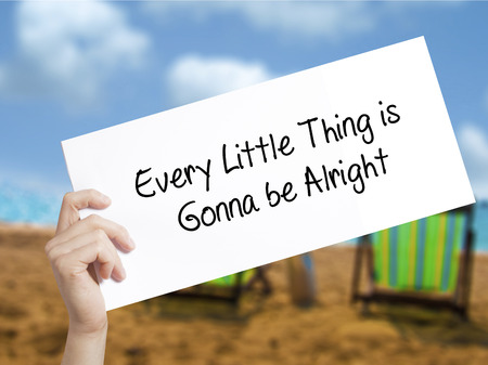 alright: Every Little Thing is Gonna be Alright Sign on white paper. Man Hand Holding Paper with text. Isolated on holiday background.  technology, internet concept.