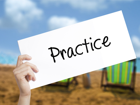 Practice Sign on white paper. Man Hand Holding Paper with text. Isolated on holiday background.  technology, internet concept.