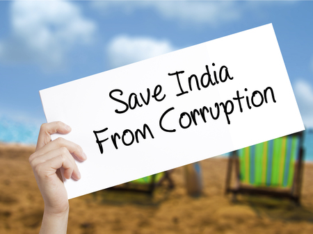 favor: Save India From Corruption Sign on white paper. Man Hand Holding Paper with text. Isolated on holiday background.  Business concept. Stock Photo