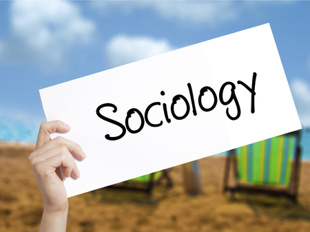 infeasible: Sociology  Sign on white paper. Man Hand Holding Paper with text. Isolated on holiday background.  Business concept. Stock Photo Stock Photo