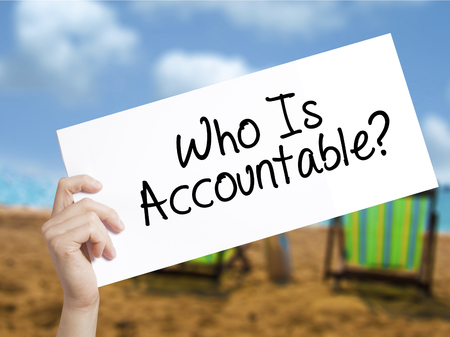 culpable: Who Is Accountable? Sign on white paper. Man Hand Holding Paper with text. Isolated on holiday background.  Business concept. Stock Photo Stock Photo