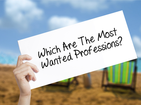 most talent: Which Are The Most Wanted Professions? Sign on white paper. Man Hand Holding Paper with text. Isolated on holiday background.  Business concept. Stock Photo Stock Photo