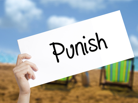 enforcing the law: Punish Sign on white paper. Man Hand Holding Paper with text. Isolated on holiday background.  Business concept. Stock Photo