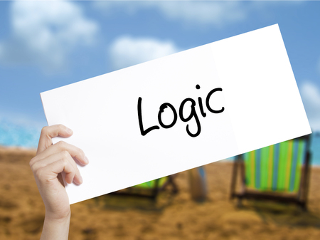 rationale: Logic Sign on white paper. Man Hand Holding Paper with text. Isolated on holiday background.  technology, internet concept.