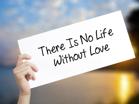 There Is No Life Without Love Sign on white paper. Man Hand Holding Paper with text. Isolated on sunset background.   Business concept. Stock Photo Stock Photo