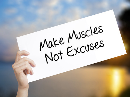 Make Muscles Not Excuses Sign on white paper. Man Hand Holding Paper with text. Isolated on sunset background.  technology, internet concept.