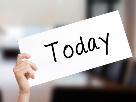 thursday: Today Sign on white paper. Man Hand Holding Paper with text. Isolated on Office background.  Business concept. Stock Photo Stock Photo