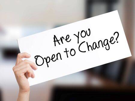 Are you Open to Change? Sign on white paper. Man Hand Holding Paper with text. Isolated on Office background.   Business concept. Stock Photo Stok Fotoğraf
