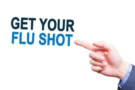 Businessman pointing on Get Your Flu Shot text sign. Isloated on white. Health concept