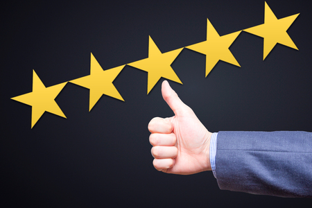 Review, rating, ranking, evaluation and classification concept. Businessman is satisfied with company 5 stars rating. Isolated on black
