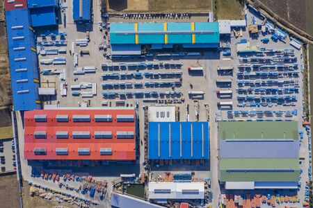 Aerial view of warehouse storages or industrial factory or logistics center from above. Aerial view of industrial buildings and equipment machines, toned Stock Photo