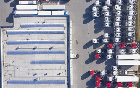 Aerial Top View of White Semi Truck with Cargo Trailer Parking