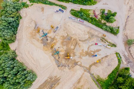 Aerial view over the building materials processing factory. Sand mine. View from above