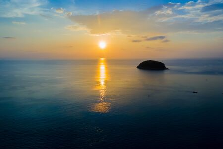 Tourism watching beautiful sea with sunset scene. Aerial View