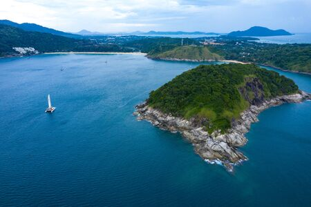 Aerial island view of Ko Man, Thailand. View Amazing view to Catamaran cruising in open sea at windy day.