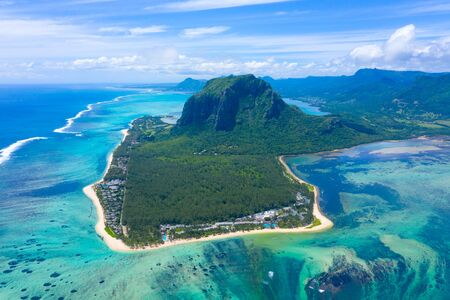 Aerial view of Le Morne Brabant .Coral reef of the island of Mauritius. panorama underwater waterfall