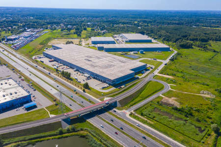Aerial top view of the large logistics park with warehouse, loading hub with many semi-trailers trucks. Banque d'images