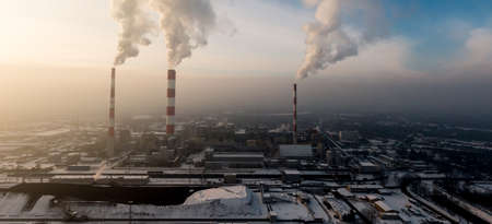 Aerial view of Industrial zone, plants and factories with smoke from chimneys. Air pollution concept. Panorama