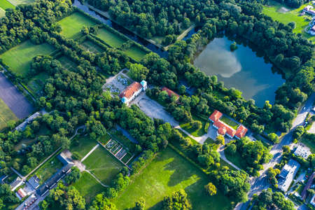 Beautiful avenue of trees of Nieborow Palace, a Baroque style residence in Poland. Colorful foliage in a French-design garden. Aerial view
