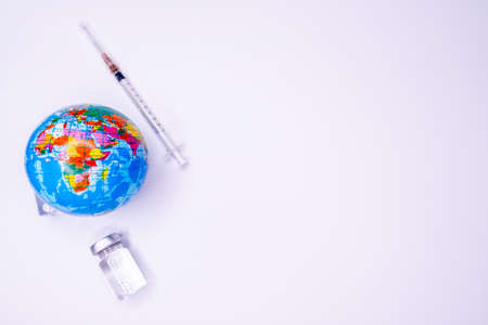 Pandemic concept, close up of scientist injecitng vaccine into the earth Standard-Bild